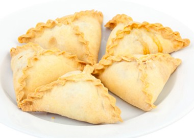 Triangle pastry with beef and potatoes
