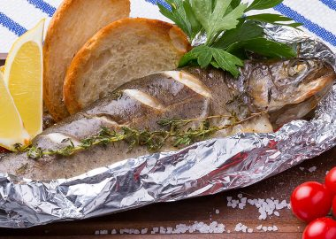 Trout baked in foil with olive oil